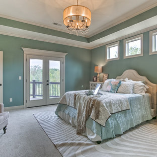 Design ideas for a large traditional master bedroom in Kansas City with green walls, carpet and white floor.