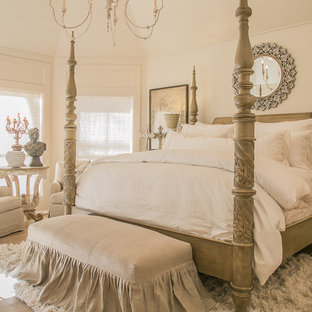 Inspiration for a shabby-chic style medium tone wood floor and brown floor bedroom remodel in Houston with white walls