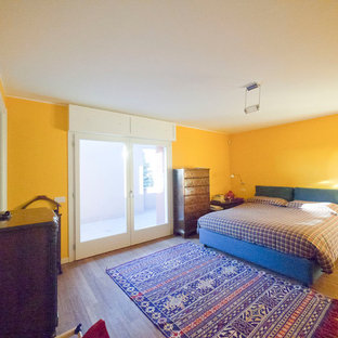 Large eclectic master bamboo floor bedroom photo in Milan with yellow walls