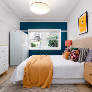 This is an example of a contemporary master bedroom in Sydney with carpet, no fireplace, beige floor and blue walls.