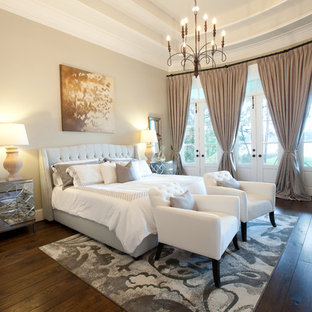 Inspiration for a timeless dark wood floor bedroom remodel in Houston with beige walls