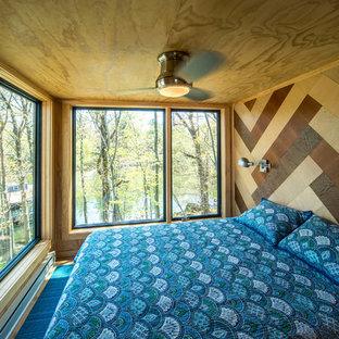 Trendy medium tone wood floor and brown floor bedroom photo in New York with brown walls
