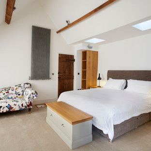 Inspiration for a mid-sized contemporary master carpeted bedroom remodel in Wiltshire with white walls