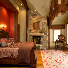 Rustic Bedroom by Sitka Log Homes