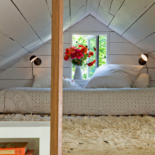 Example of a cottage chic loft-style bedroom design in Portland