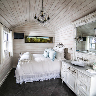 Example of a small cottage chic master porcelain tile bedroom design in Charlotte with white walls