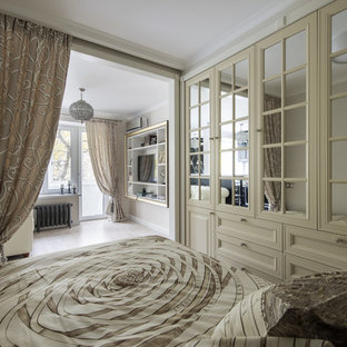 Inspiration for a traditional master bedroom in Moscow with white walls and light hardwood floors.