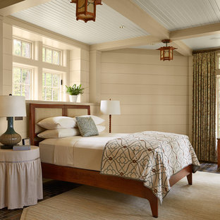 Photo of a large country master bedroom in Minneapolis with slate floors, no fireplace, beige walls and brown floor.