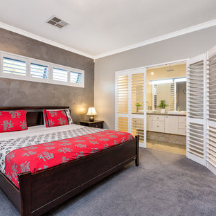 This is an example of an asian master bedroom in Perth with grey walls, carpet and grey floor.