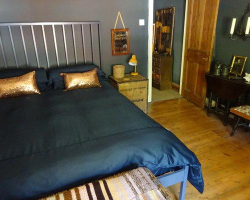 Chambre clectique avec un po le bois photos et id es for Taille moyenne chambre