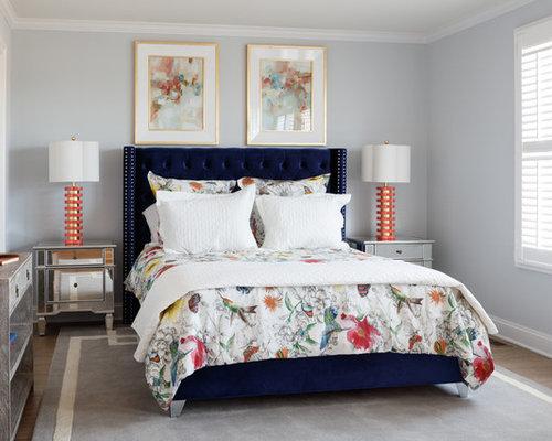Camera da letto con pavimento in laminato e pareti blu - Foto e Idee ...