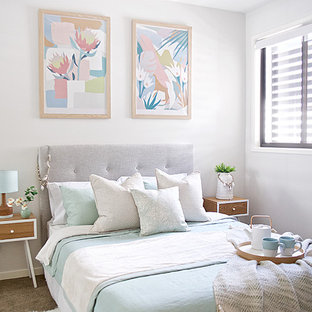 Inspiration for a mid-sized transitional guest bedroom in Brisbane with grey walls, carpet and beige floor.
