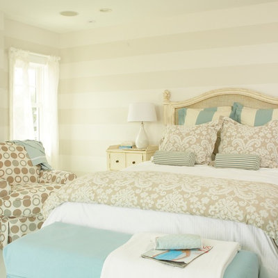 Bedroom - mid-sized coastal master painted wood floor and blue floor bedroom idea in Tampa with beige walls and no fireplace