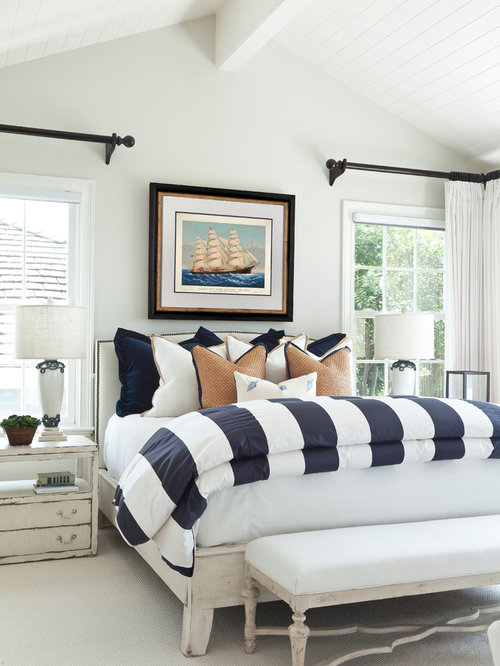 Large Beach Style Master Carpeted Bedroom Idea In Orange County With White  Walls. Save Photo. Barclay Butera Interiors