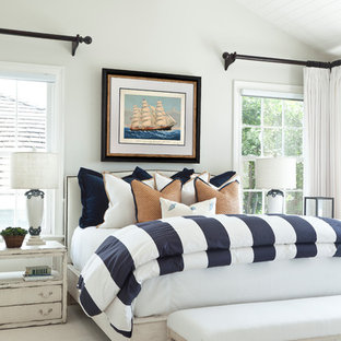 Bedroom - large coastal master carpeted bedroom idea in Orange County with white walls