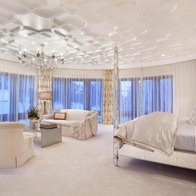 Elegant bedroom photo in Miami with beige walls