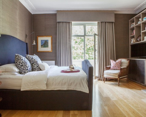 photo of a classic bedroom in london with beige walls and light hardwood flooring - Cream Bedroom Ideas