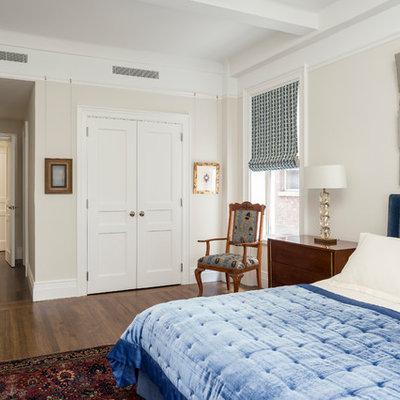 Bedroom - traditional medium tone wood floor and brown floor bedroom idea in New York with beige walls