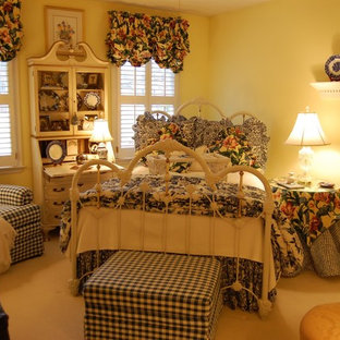 Inspiration for a timeless carpeted bedroom remodel in Other with beige walls