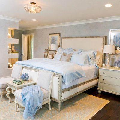 Inspiration for a timeless dark wood floor bedroom remodel in Orange County with gray walls