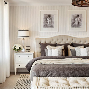 Photo of a traditional master bedroom in Melbourne with beige walls and carpet.