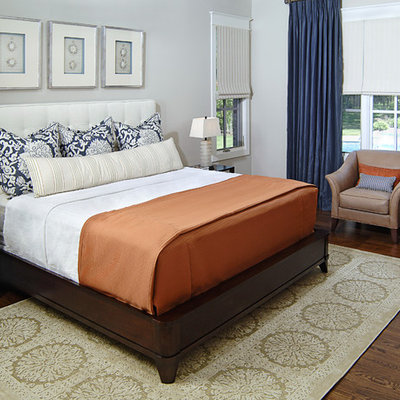 Example of a classic master dark wood floor bedroom design in Dallas with gray walls and no fireplace