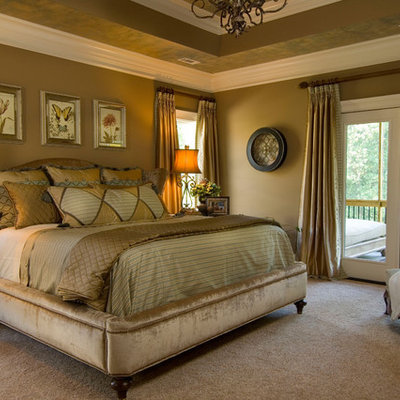 Inspiration for a timeless carpeted bedroom remodel in Other with brown walls and no fireplace