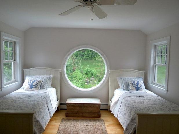 Finestre circolari alta di colore grigio disegnata al suo for Piccole case quadrate
