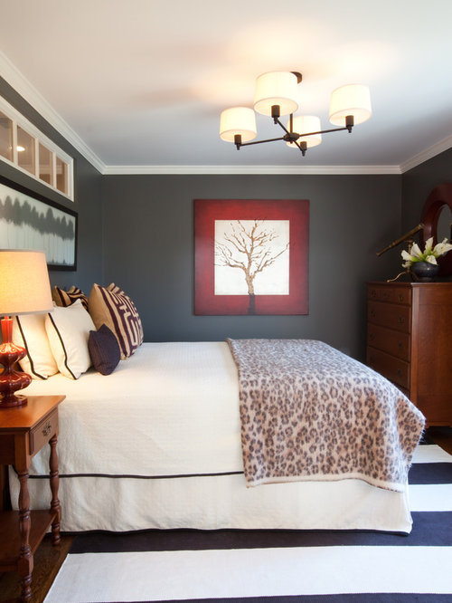Inspiration for a timeless bedroom remodel in Other with gray walls