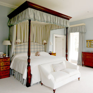 Inspiration for a timeless master carpeted bedroom remodel in London with blue walls