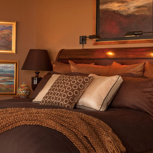 This is an example of a traditional bedroom in Portland with brown walls.
