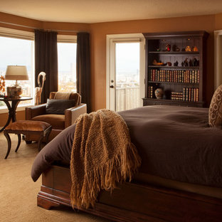 Elegant carpeted bedroom photo in Portland with brown walls