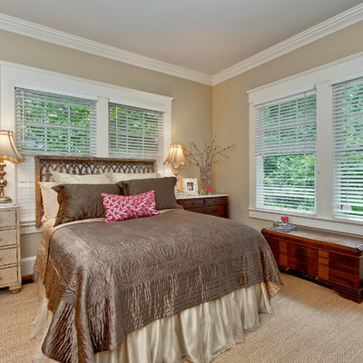 Inspiration for a timeless bedroom remodel in Charlotte with beige walls