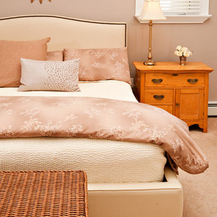 Elegant carpeted bedroom photo in Other with beige walls