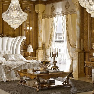 Large elegant master marble floor bedroom photo in Miami with brown walls