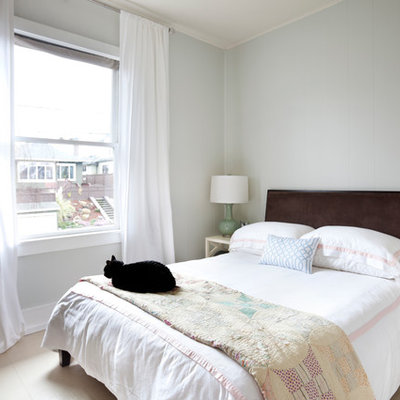 Elegant bedroom photo in Other with gray walls