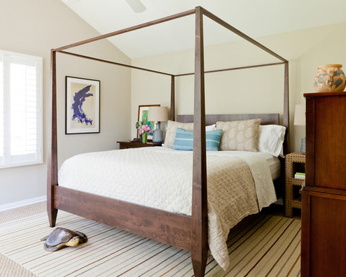 Example Of A Classic Carpeted Bedroom Design In Austin With White Walls