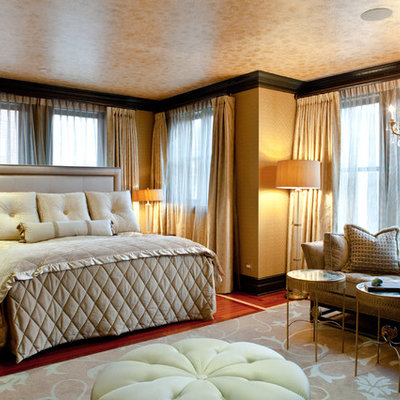 Inspiration for a timeless medium tone wood floor bedroom remodel in Chicago with beige walls
