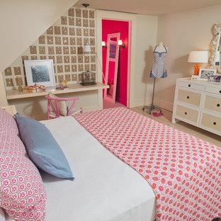 Example of a classic light wood floor bedroom design in DC Metro with beige walls