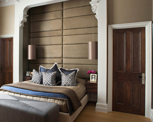 example of a classic bedroom design in london with brown walls - Elegant Bedroom Ideas