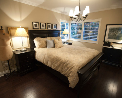 Black Bedroom Furniture   Houzz Small traditional master bedroom idea in Vancouver with beige walls and  dark hardwood floors. Black Bedroom Furniture. Home Design Ideas