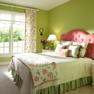 Photo of a traditional bedroom in San Diego with green walls, carpet and no fireplace.