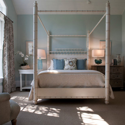 Elegant guest medium tone wood floor bedroom photo in Jacksonville with blue walls and no fireplace