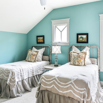 Example of a farmhouse guest carpeted bedroom design in Louisville with blue walls