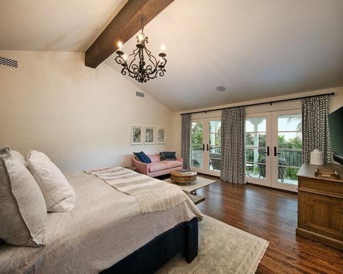 Large Mediterranean Master Dark Wood Floor And Brown Floor Bedroom Idea In  Santa Barbara With White