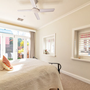 Inspiration for a transitional master bedroom in Newcastle - Maitland with beige walls, carpet and beige floor.