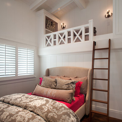Beach style bedroom photo in San Diego with white walls