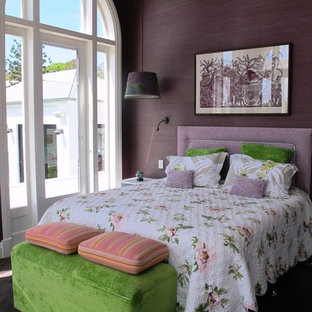 Example of a transitional carpeted bedroom design in Brisbane with purple walls