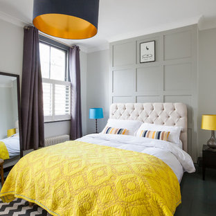 Medium sized traditional bedroom in London with grey walls, painted wood flooring, black floors and no fireplace.