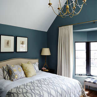 Transitional bedroom in Toronto with blue walls and dark hardwood floors.